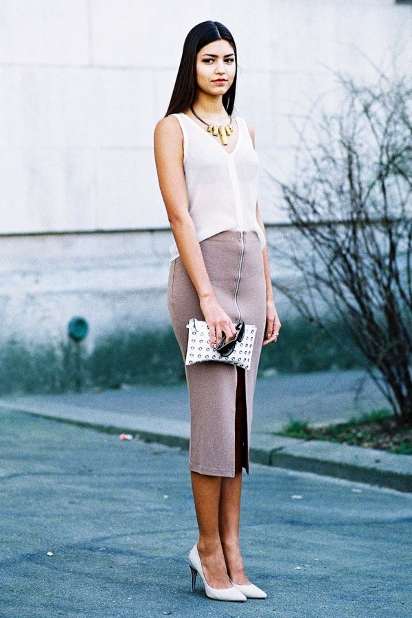 97810ec4f6 How to wear the knit skirt trend: half tuck a tank, statement accessories,