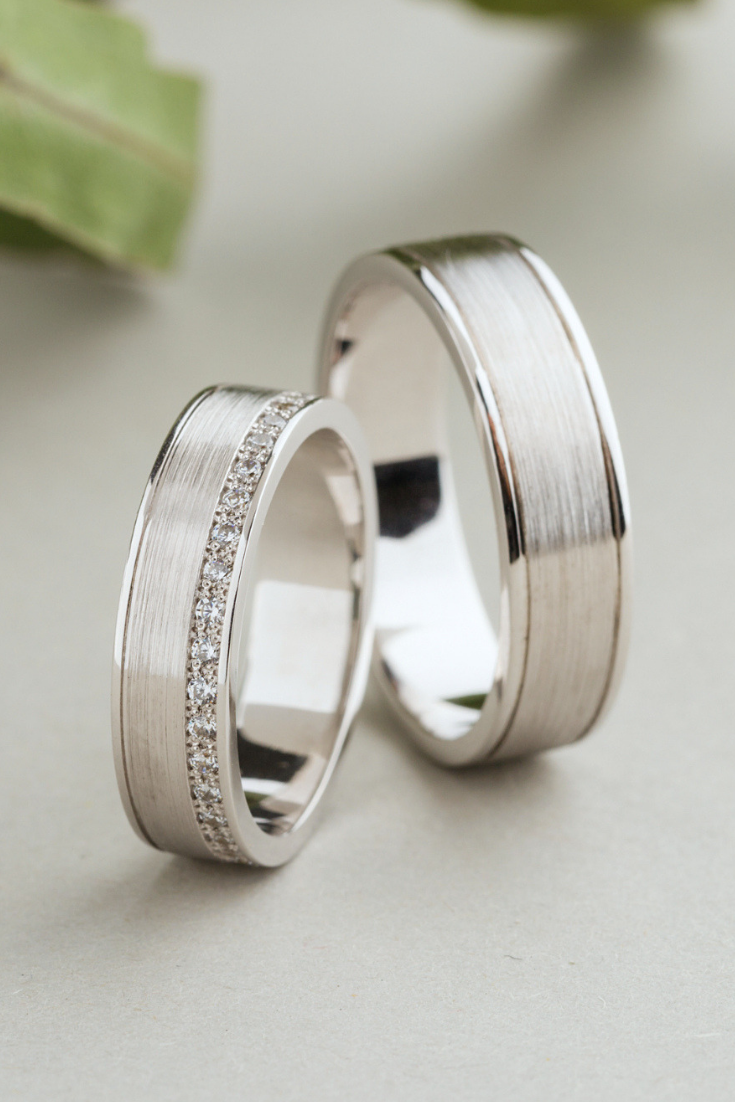 It is a photo of His and hers wedding bands made of 48k gold with diamonds. Etsy