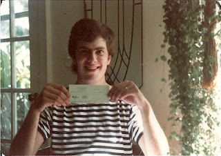"""That's me, circa 1985 in Oregon, beaming over the first money I ever received for my published work: a best-forgotten short story called """"Dance of the Dinosaurs"""" which appeared in the just-launched Eugene Magazine."""