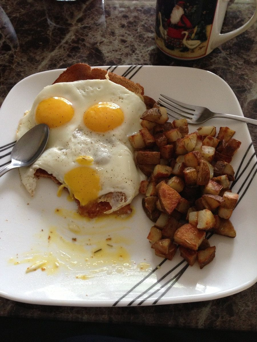 Cubed potatoes with rosemary and salt, eggs, toast and coffee