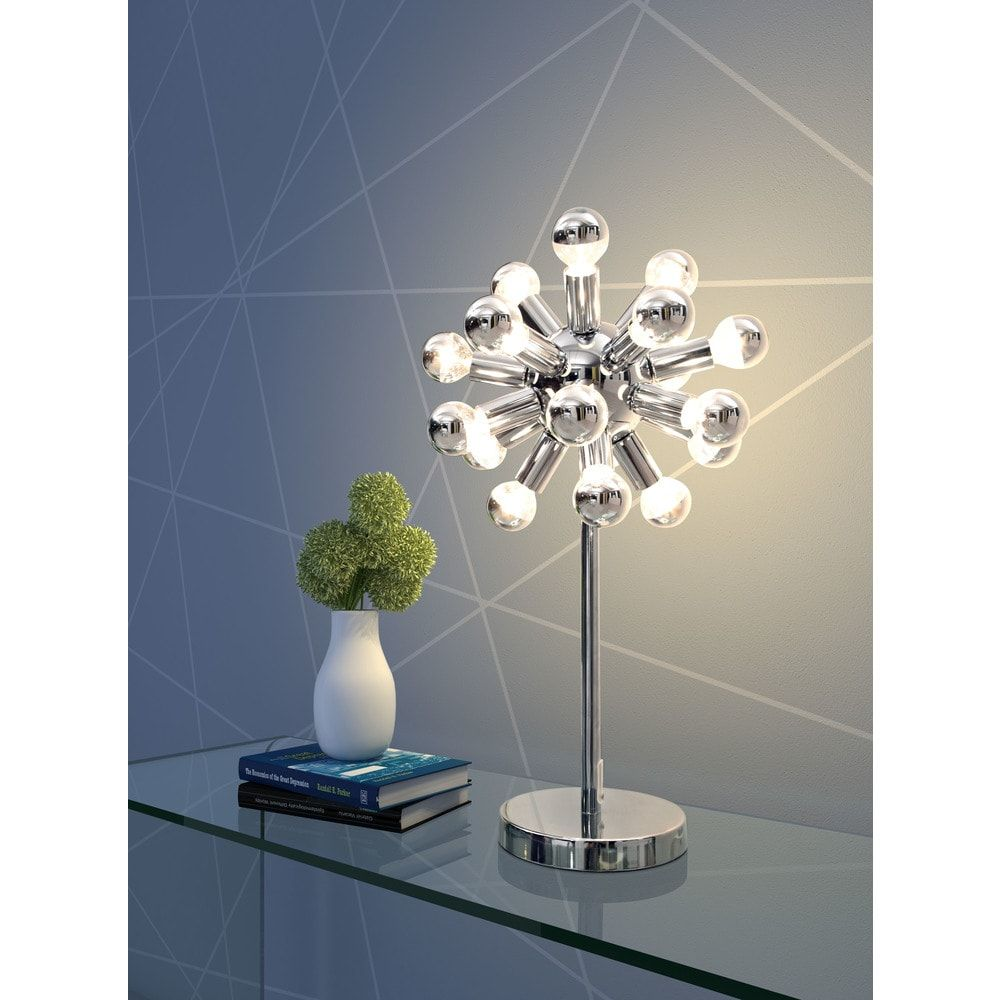 Illuminate your office area with this distinct-looking chrome-finished table lamp. Perfect for nearly any surface, this chrome-plated desk lamp will give your home office a unique feel, and your friends, family, or clients will be awe-struck by its brilliant design. This lamp also includes a one-year limited manufacturer's warranty. Fixture finish: Chrome In-line switch Number of lights: 18 Requires 18 G50 (bulb not included) UL approved Dimensions: 21.7 inches high x 15 inches wide x 15 inches