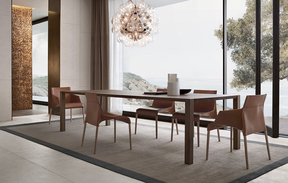 Blade dining table with structure and top in solid wood walnut canaletto  and Seattle chairs in the versions with and without armrest. Poliform Varenna 2015 16 18560 1 1               Pinterest   Solid