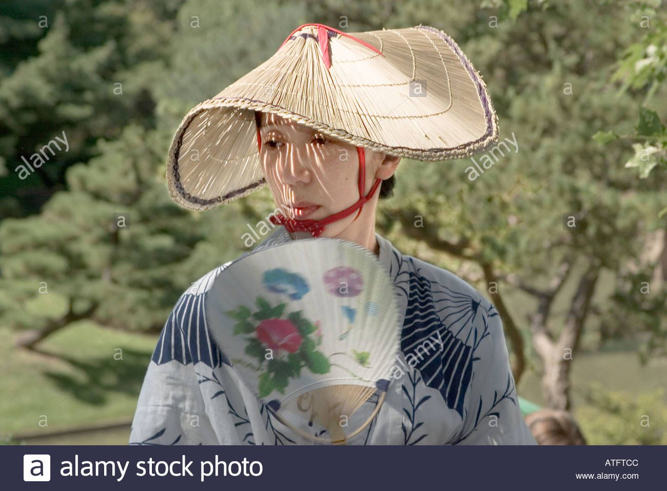 Download This Stock Image A Japanese Woman In Traditional Dress With Straw Hat And Fan At The Annual Japanese Festi Japanese Festival Japanese Women Straw Hat