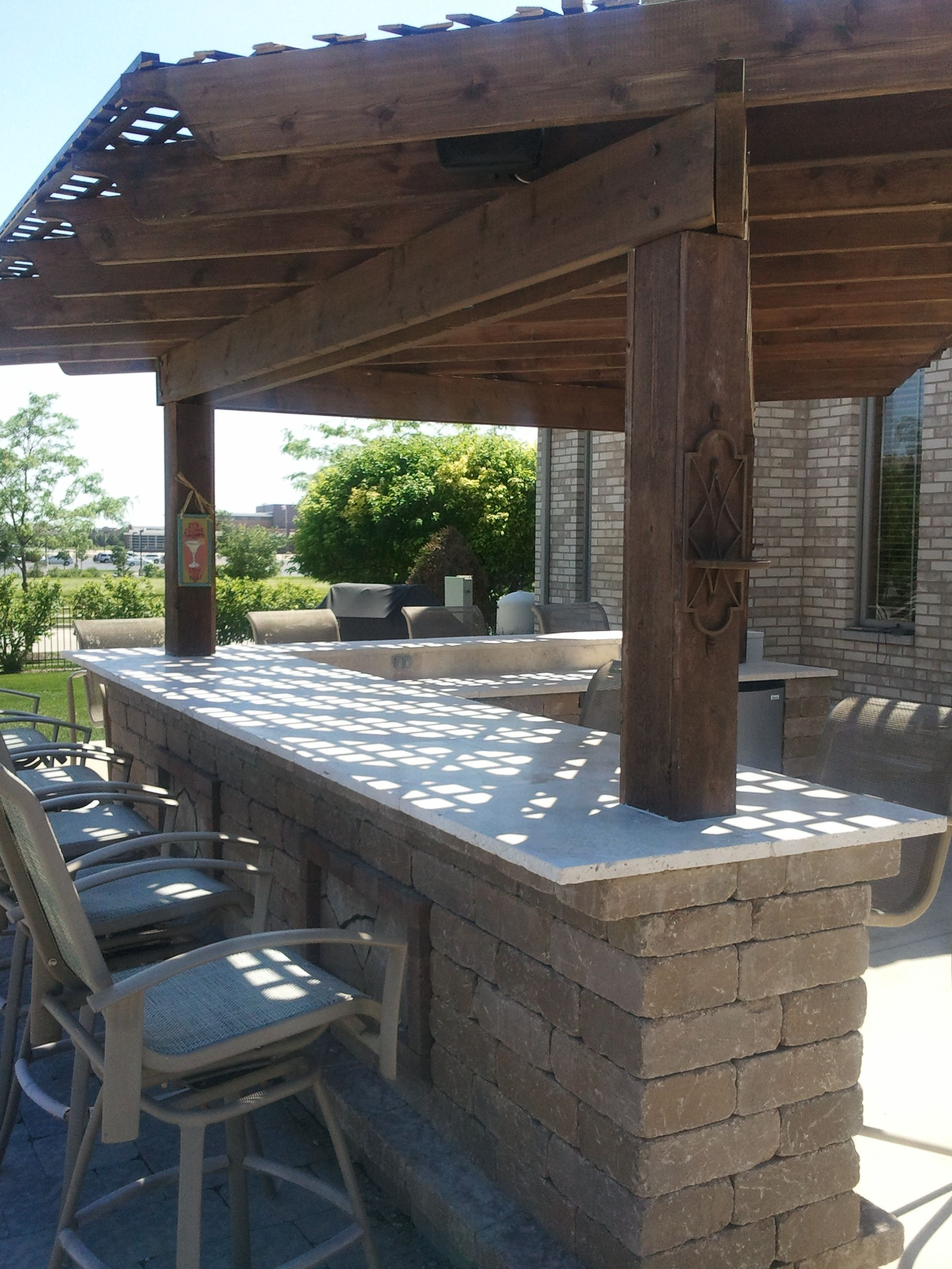 a pergola is a great way to add shade to your outdoor kitchen without overpowering the space on outdoor kitchen plans layout id=49853