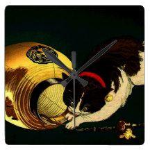 cat and latern clocks