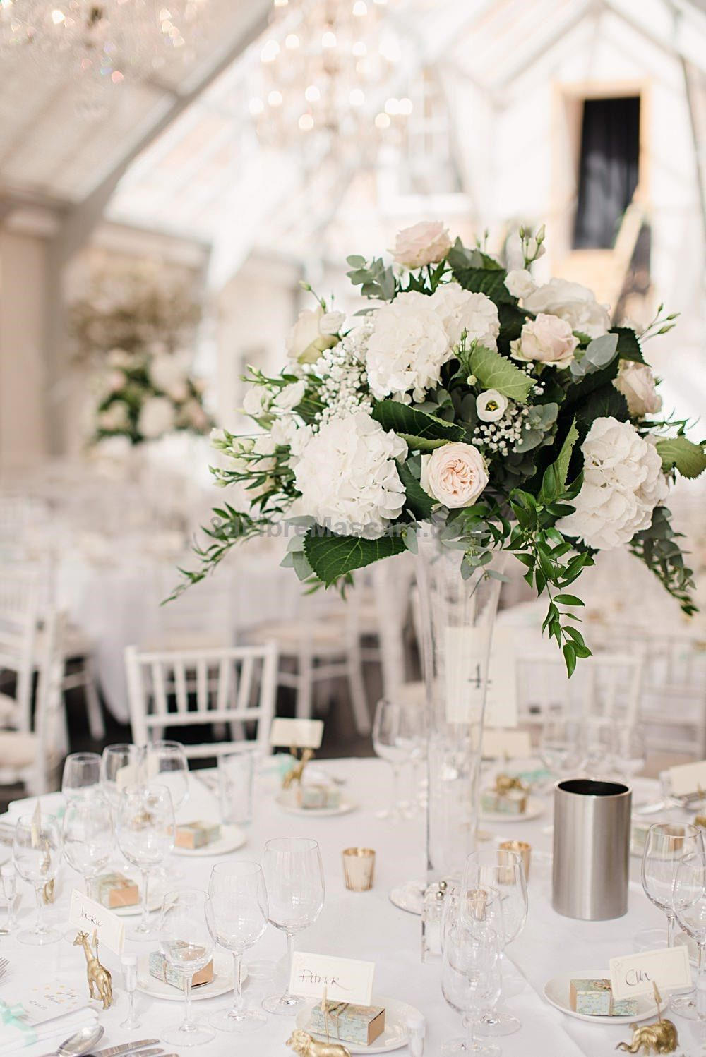 Tall bride wedding dress  Tall White Flower Centrepieces  Classic Wedding at Botleys Mansion
