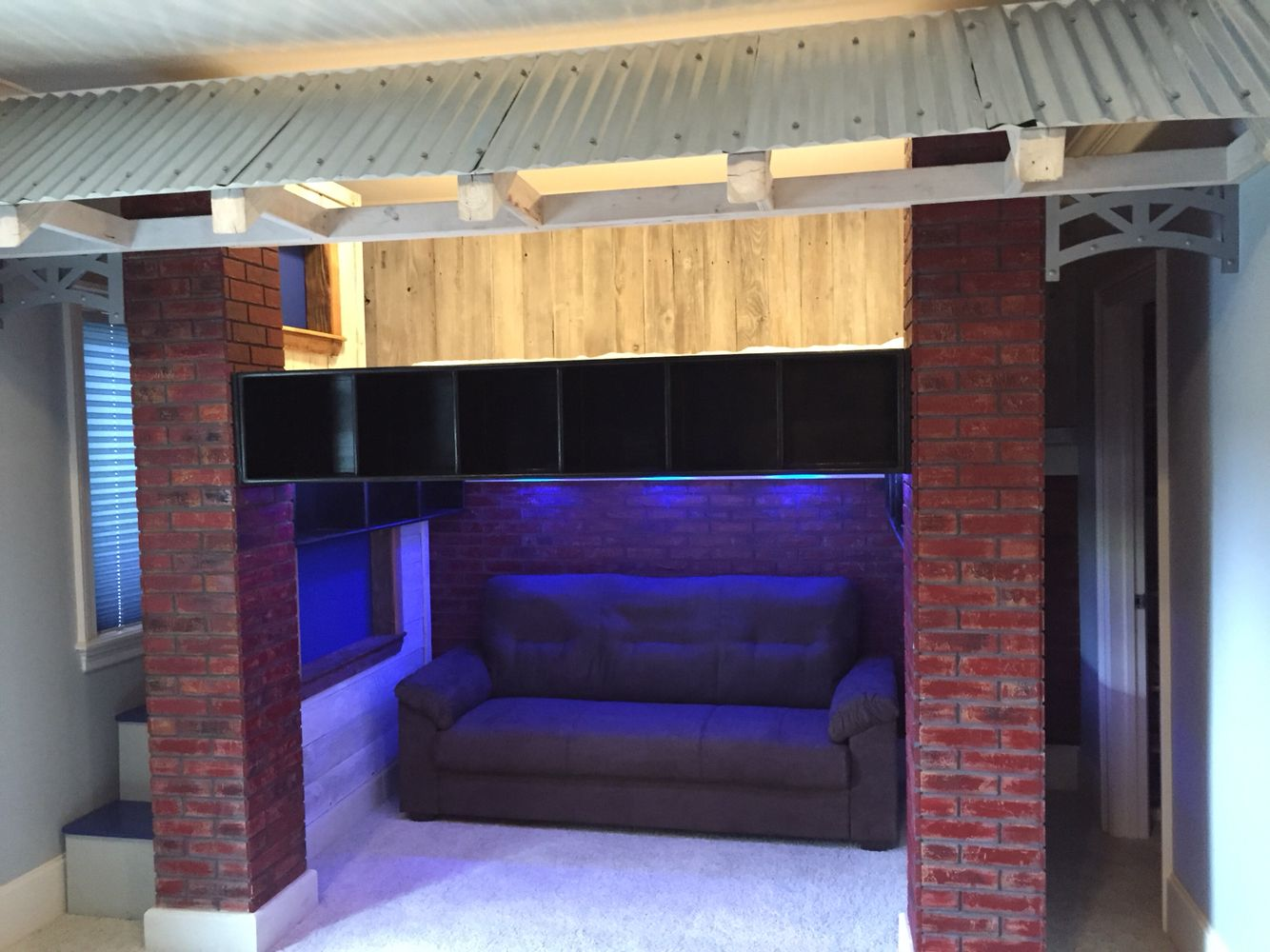 Baseball Dugout Loft Bed Faux Brick Walls And Columns With Lounge Sofa Beneath