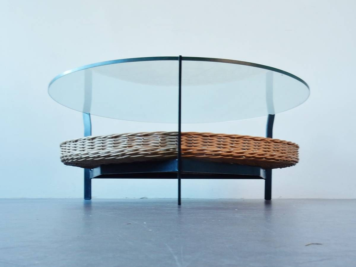 Coffee table of a metal frame, wicker basker and glass top ...