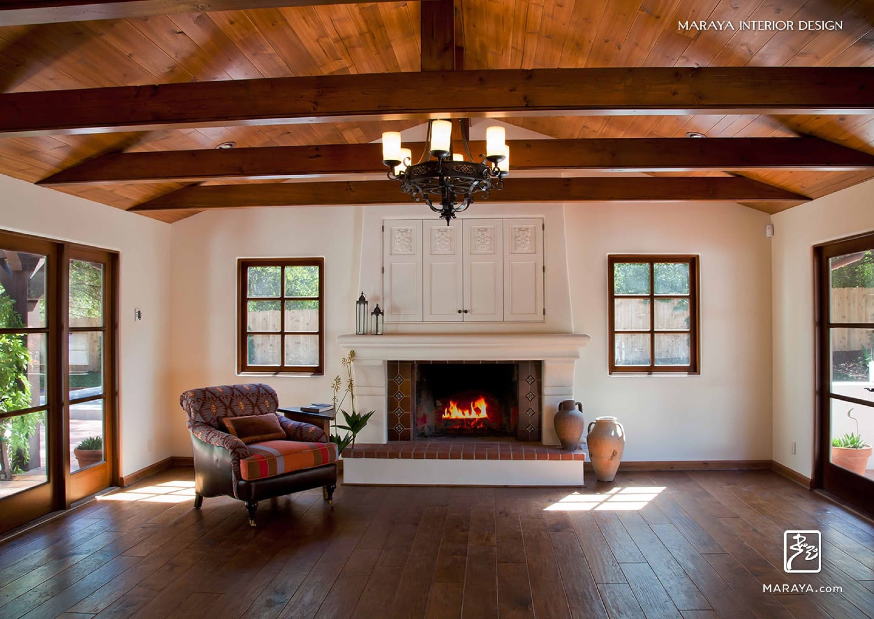 Spanish mediterranean family room with plaster fireplace for Spanish style fireplace