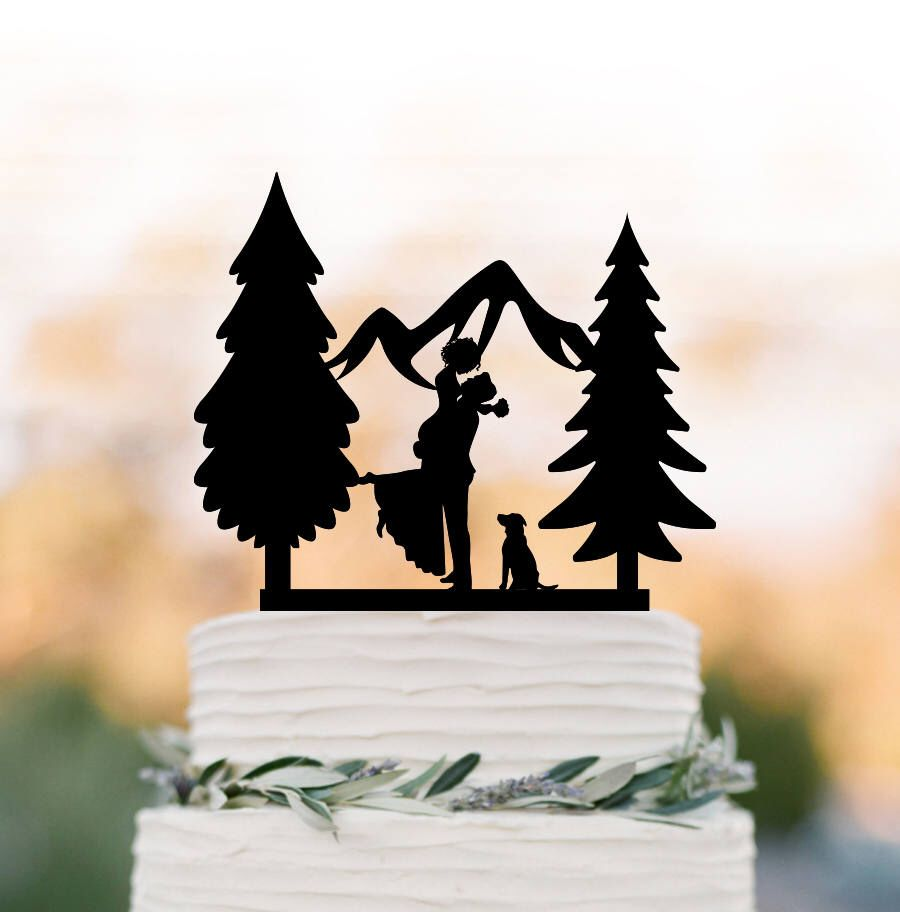 Outdoors wedding cake topper mountain with dog cake topper tree