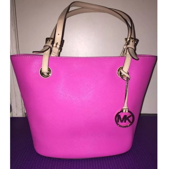 """Authentic Michael Kors Jet Set Saffiano Handbag Used only a few times, still in great condition!  Material: Saffiano Leather in Pink  Shoulder style bag features double handles for easy carrying Quality leather  Logo patterned lining Button close, goldtone hardware Dimensions: 10""""H x 15""""W x 9""""D Michael Kors Bags Shoulder Bags"""
