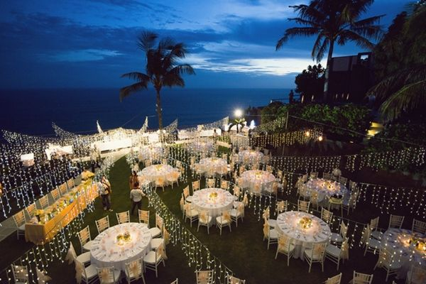 Outdoor wedding reception decor night besides beach for Beach house reception ideas