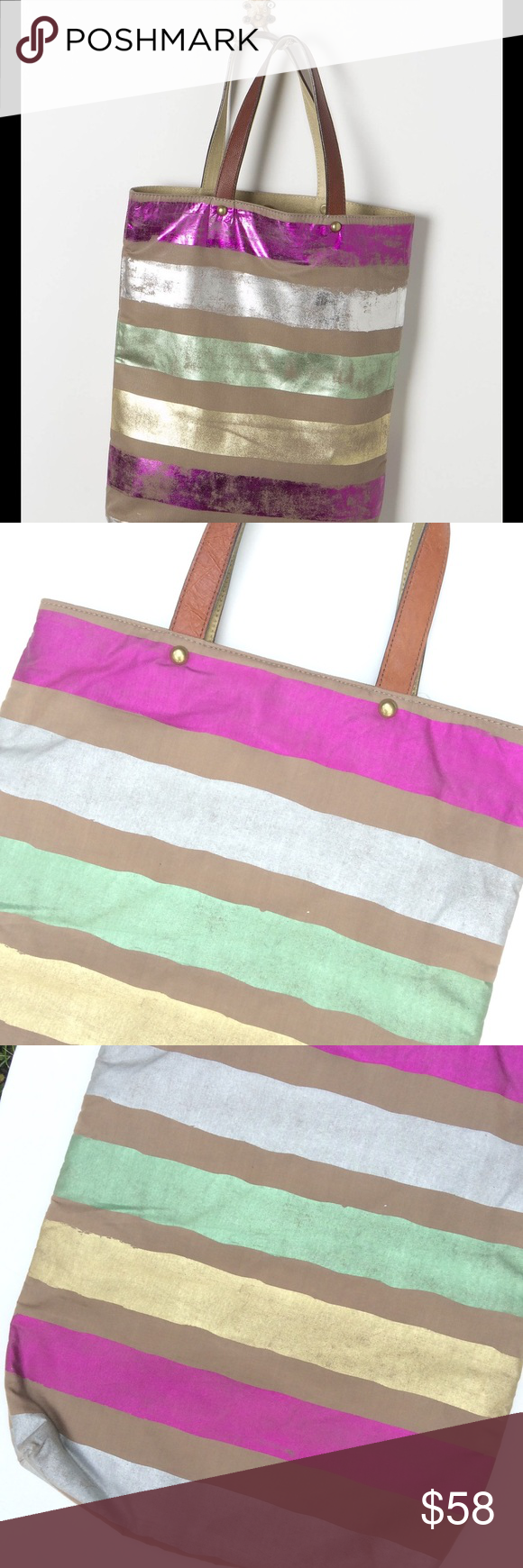 Anthropologie Jasper and Jeera Foil Striped Tote Gorgeous shimmery Summery tote from Anthro. Such awesome quality, real leather handles. Snap closure. Zippered pocket, two open pockets on inside. Brand new never used. Line drawn through name. Anthropologie Bags Totes