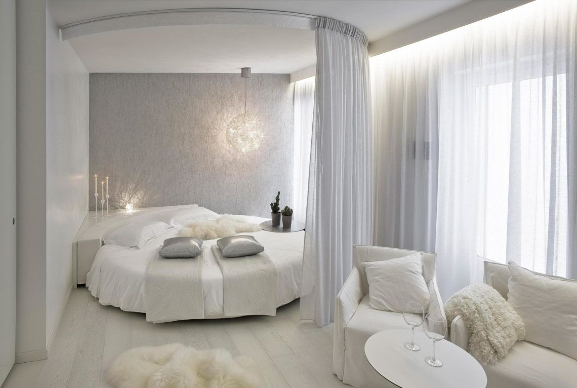 Luxurious white bedroom for girls with round bed with ...