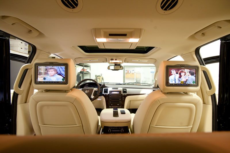 dual headrest dvd players installed in a cadillac escalade these dvd headrests are a complete. Black Bedroom Furniture Sets. Home Design Ideas