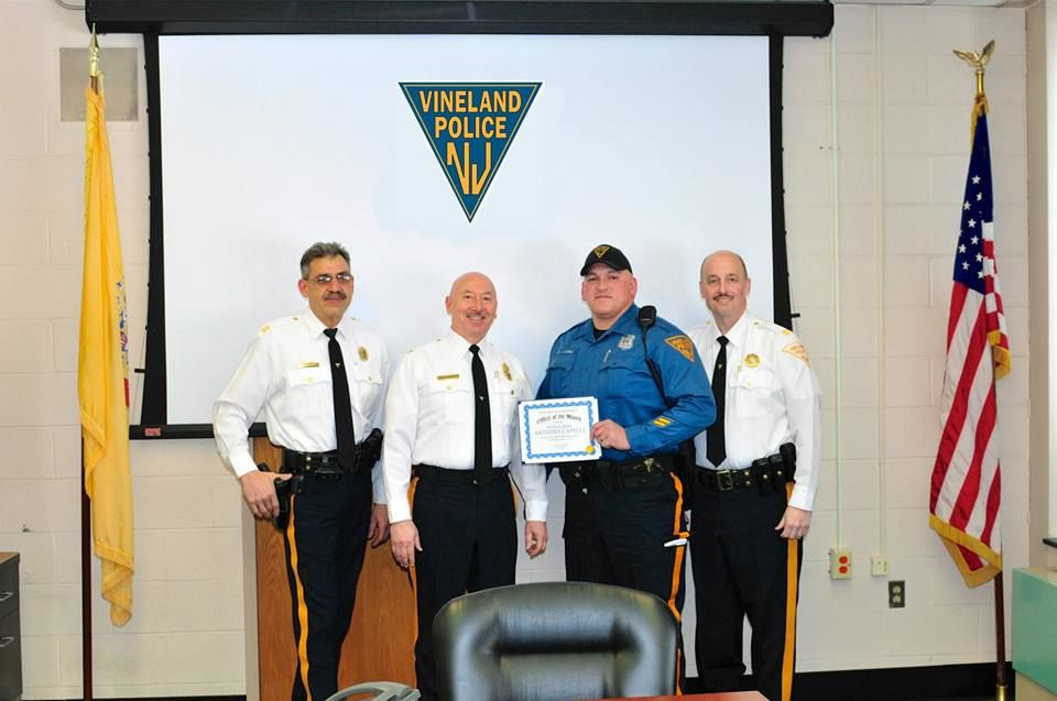 Officer Anthony Capelli with Chief Codispoti and Captains John Lauria and Tom Ulrich — at Vineland, NJ Police Department.