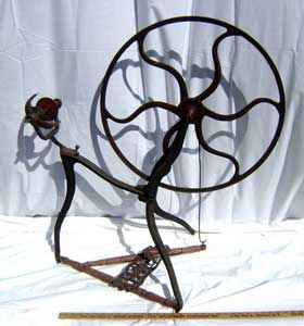 Carlton's cast-iron wheel.  It's a good thing I'm not independently wealthy. I'd blow my money on collecting spinning wheels.