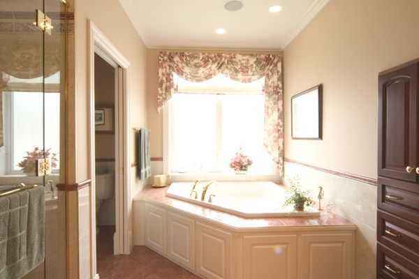 Water closet, custom shower and jacuzzi.