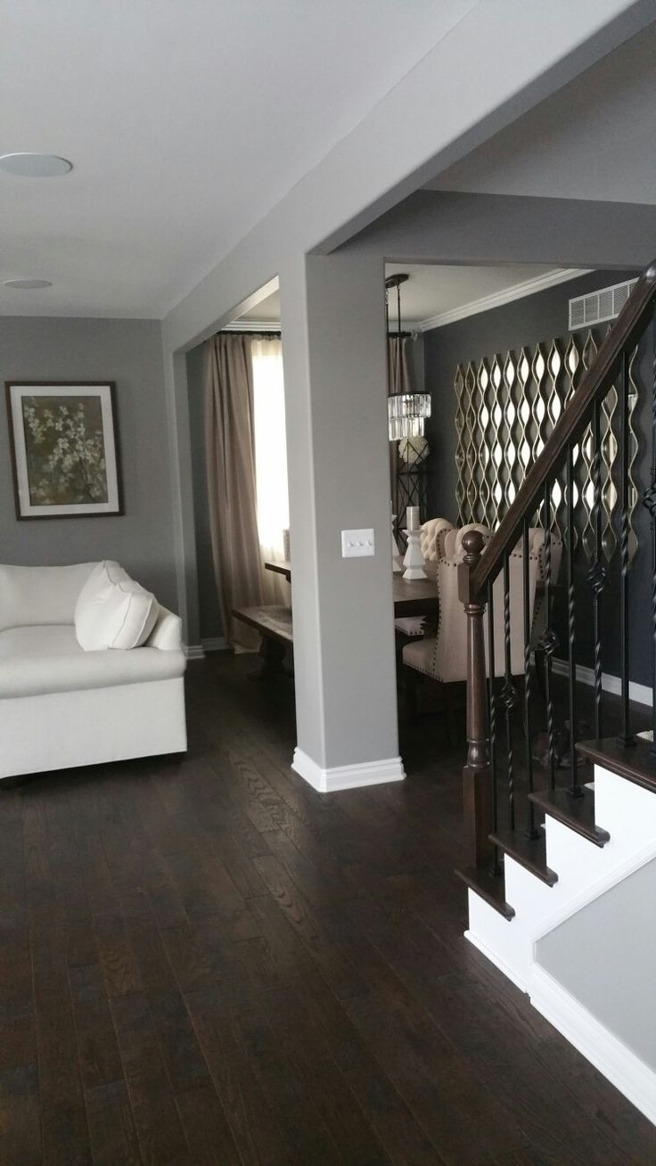 Gray walls and dark wood floors. | Grey walls living room ...