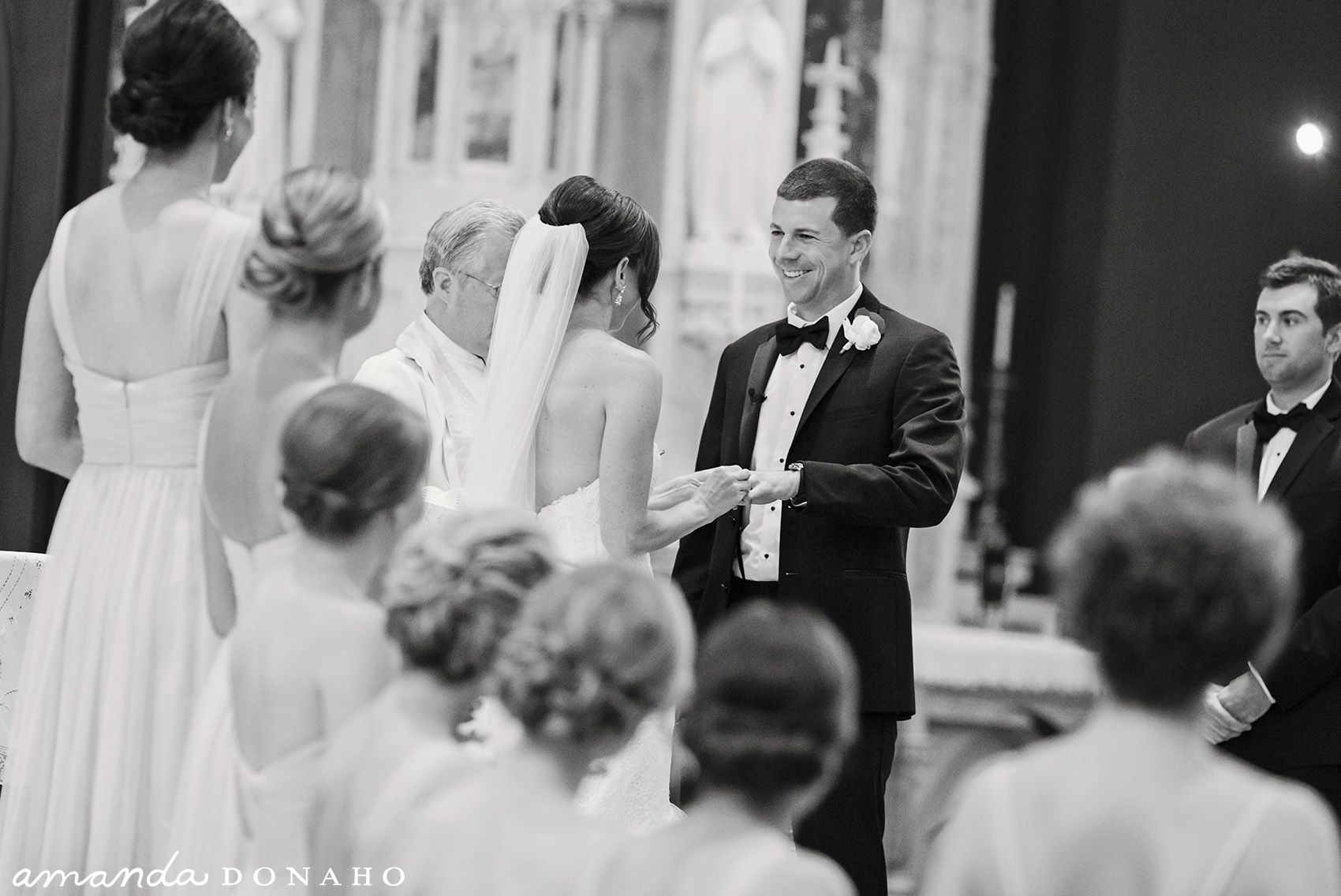Timeless and classic photo of bride and groom exchanging vows on