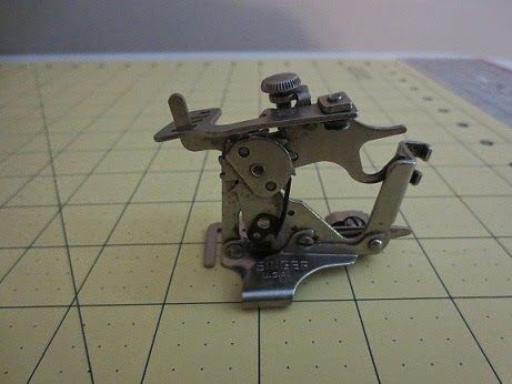 The ruffler foot for the Singer 401A.  It's ages old and it still works great.  Amazing tool.