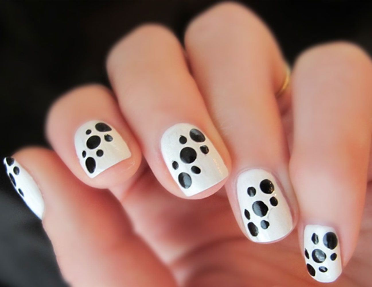 White base with black dots in a pattern so cute it seems like it