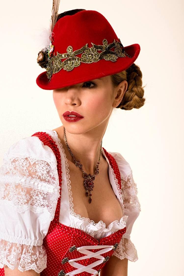 Dirndl Frisur - Ein origineller, roter Hut dient als ...