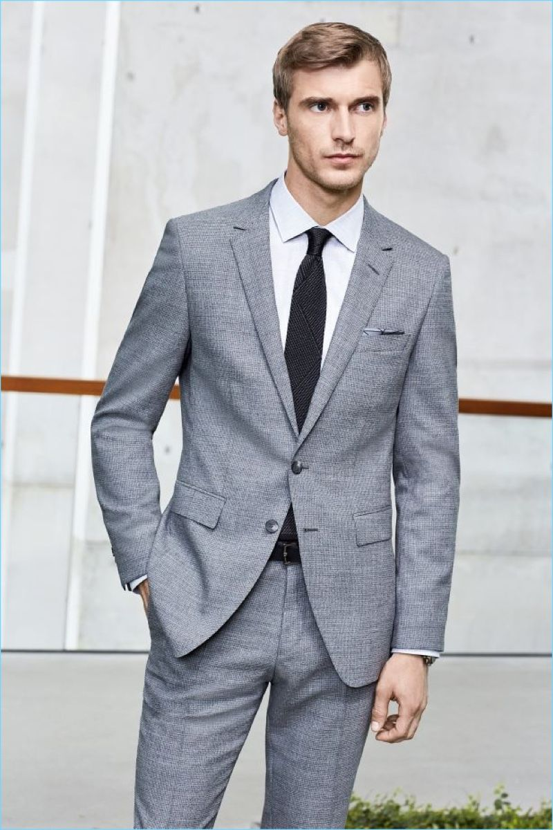 f754c73e4566 Clément Chabernaud dons a grey two-button suit from BOSS Hugo Boss   pre-spring 2017 collection.