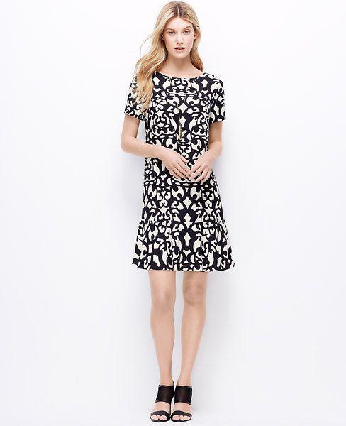 """Fit to print: we think a bold print dress with high impact hues and a flirty flounce hem makes your wardrobe look new and now instantly. Strappy heels add evening-ready edge to the look. Boatneck. Short sleeves. Flounce hem. 19"""" from natural waist."""