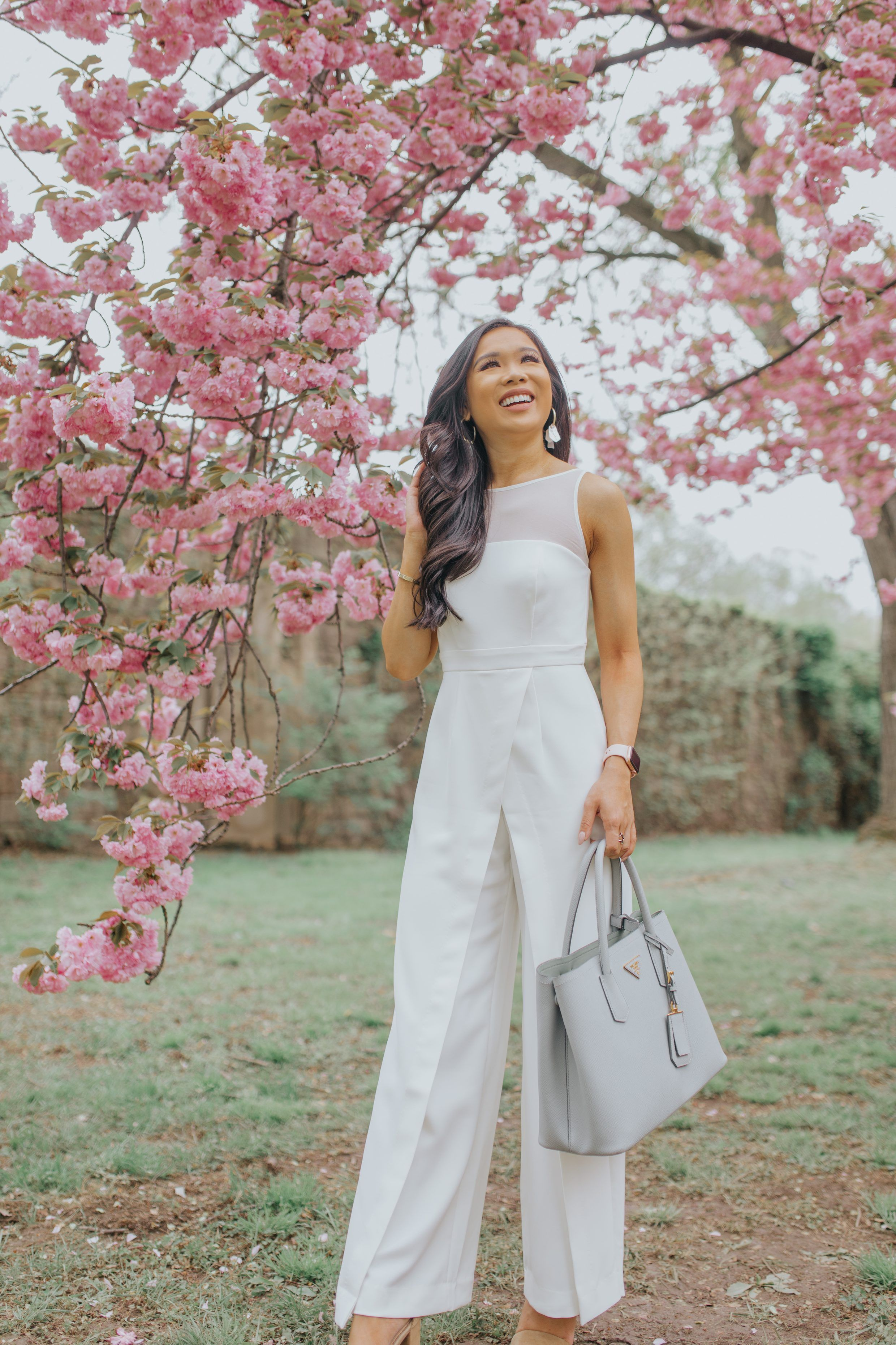 287d72ad6 Hoang-Kim wears a white statement jumpsuit amidst the cherry blossoms in  Washington, D.C.   jumpsuit summer jumpsuit casual jumpsuit elegant jumpsuit  prom ...