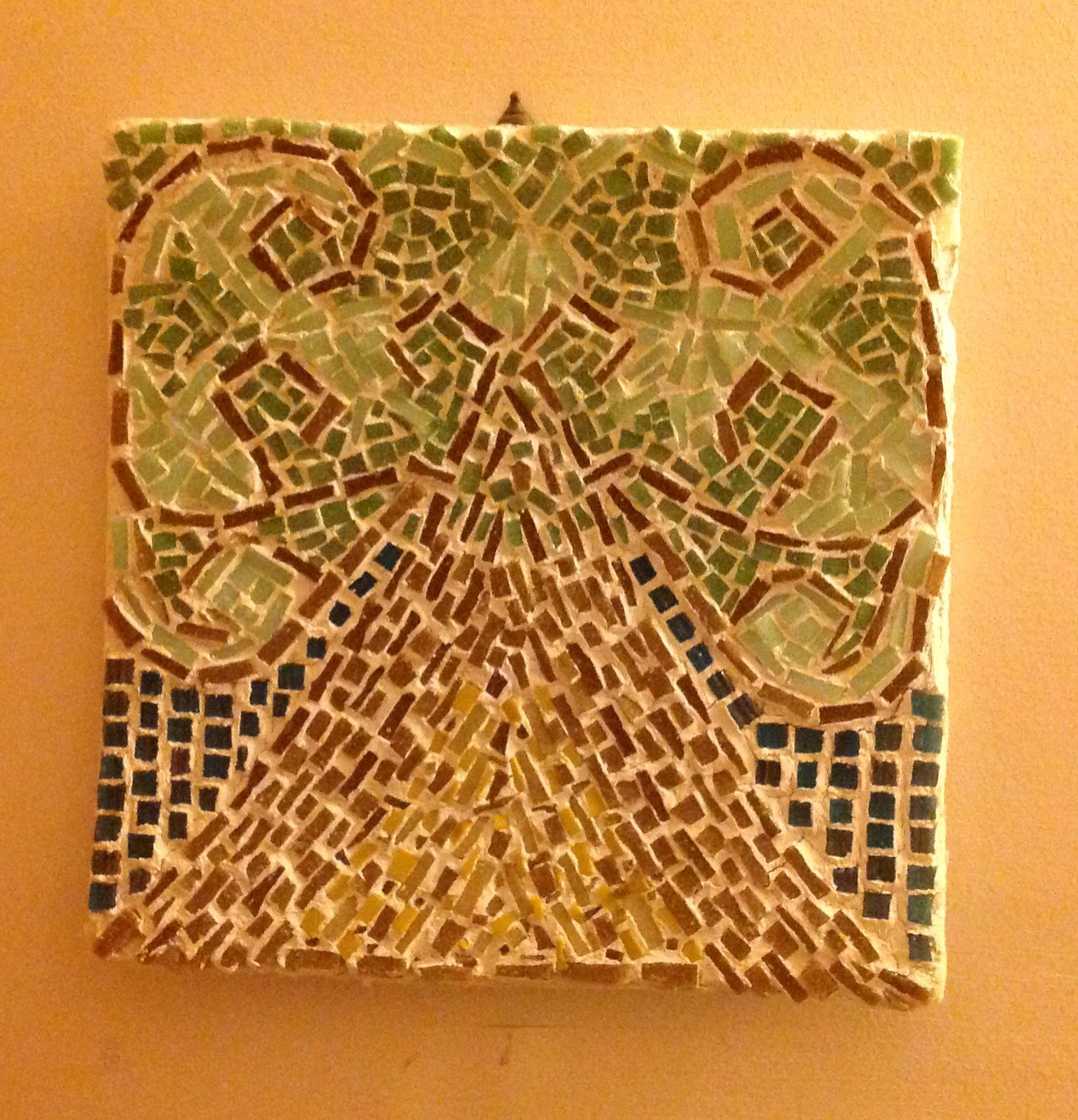 mosaic tile made on a cardboard poster from cvs the grout makes