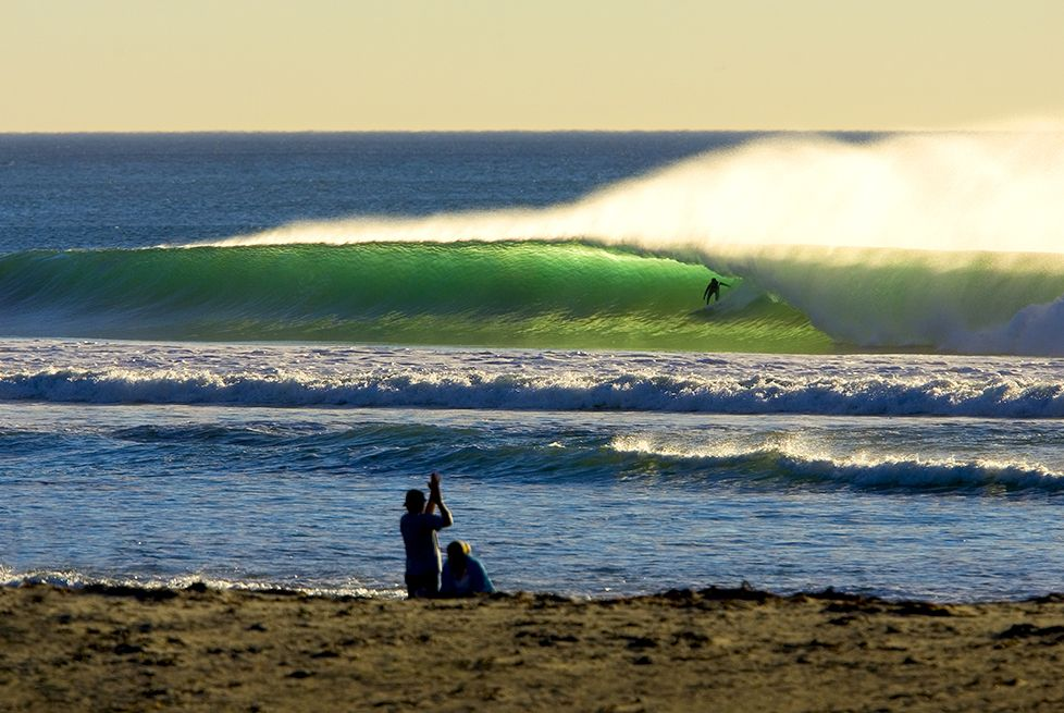 7ffeb695a34 Experience the pure joy of riding a wave with this beach photo by ...