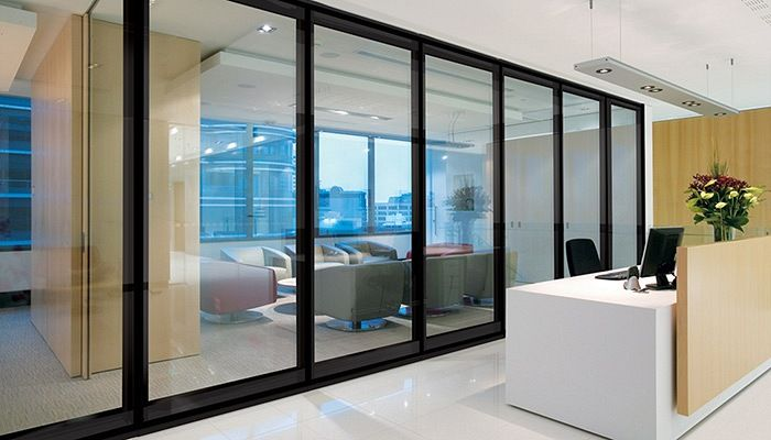 Glass operable walls - powdercoat frame white, laser perforated ...