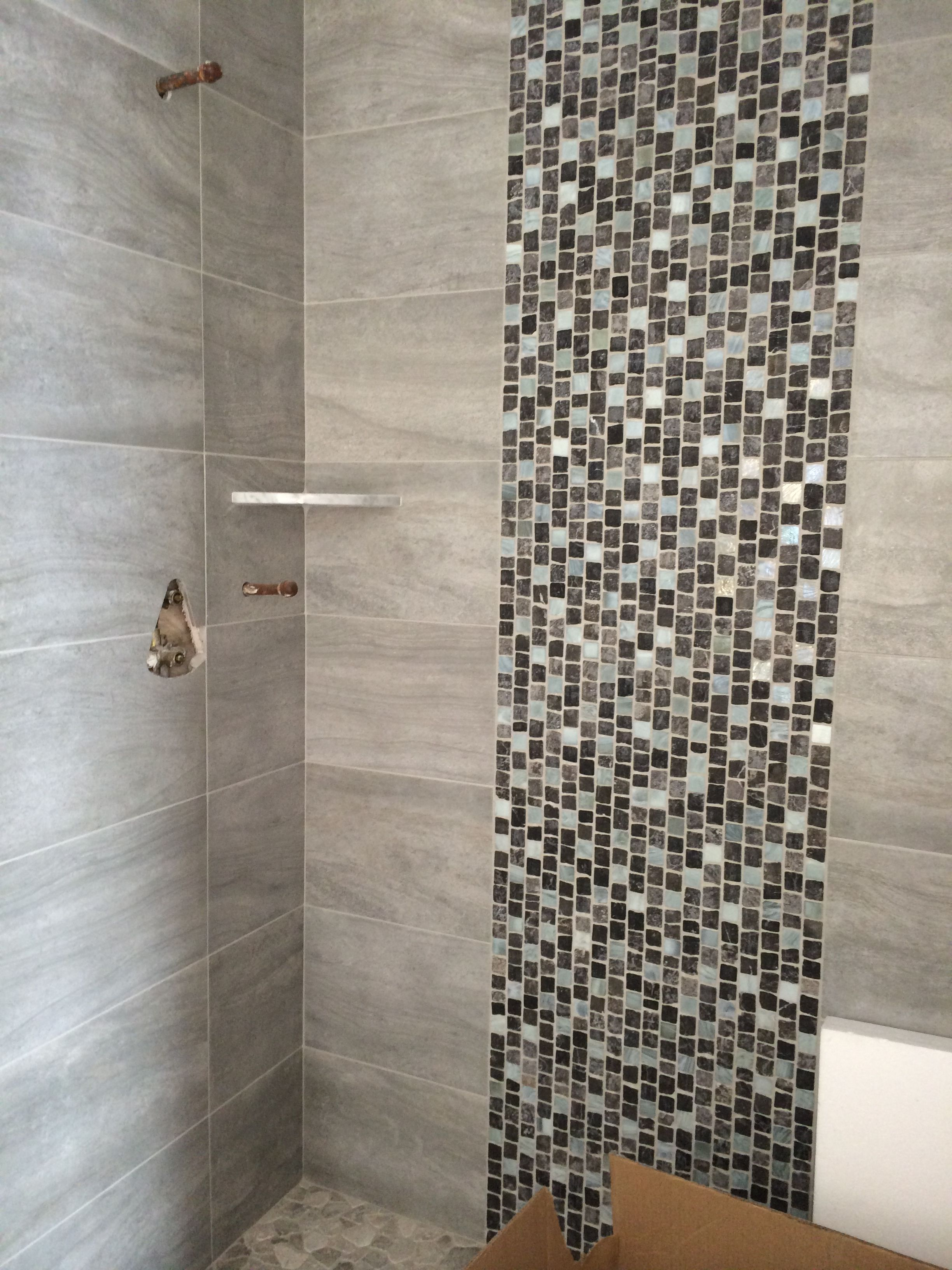 12 X 24 Porcelain Shower Walls W Stone And Glass Tile Lisello Staggered Stone Shower Floor In Progress Shower Wall Tile Tile Bathroom Bathroom Tile Designs