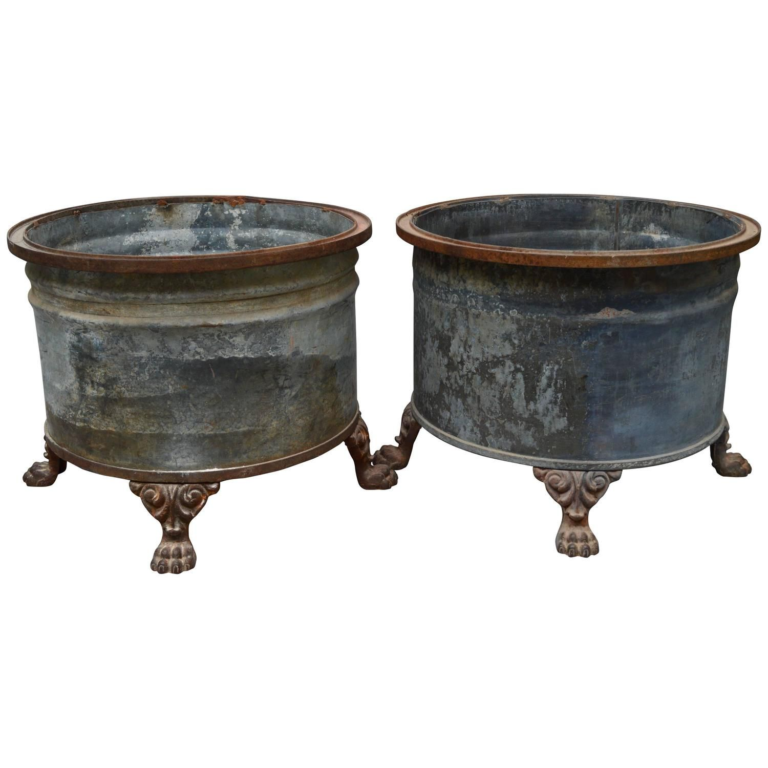 vintage small metal planter supported by four lion paw legs.