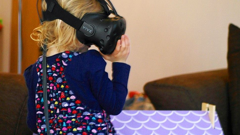 HTC Vive used to give girl a VR tour of her dollhouse