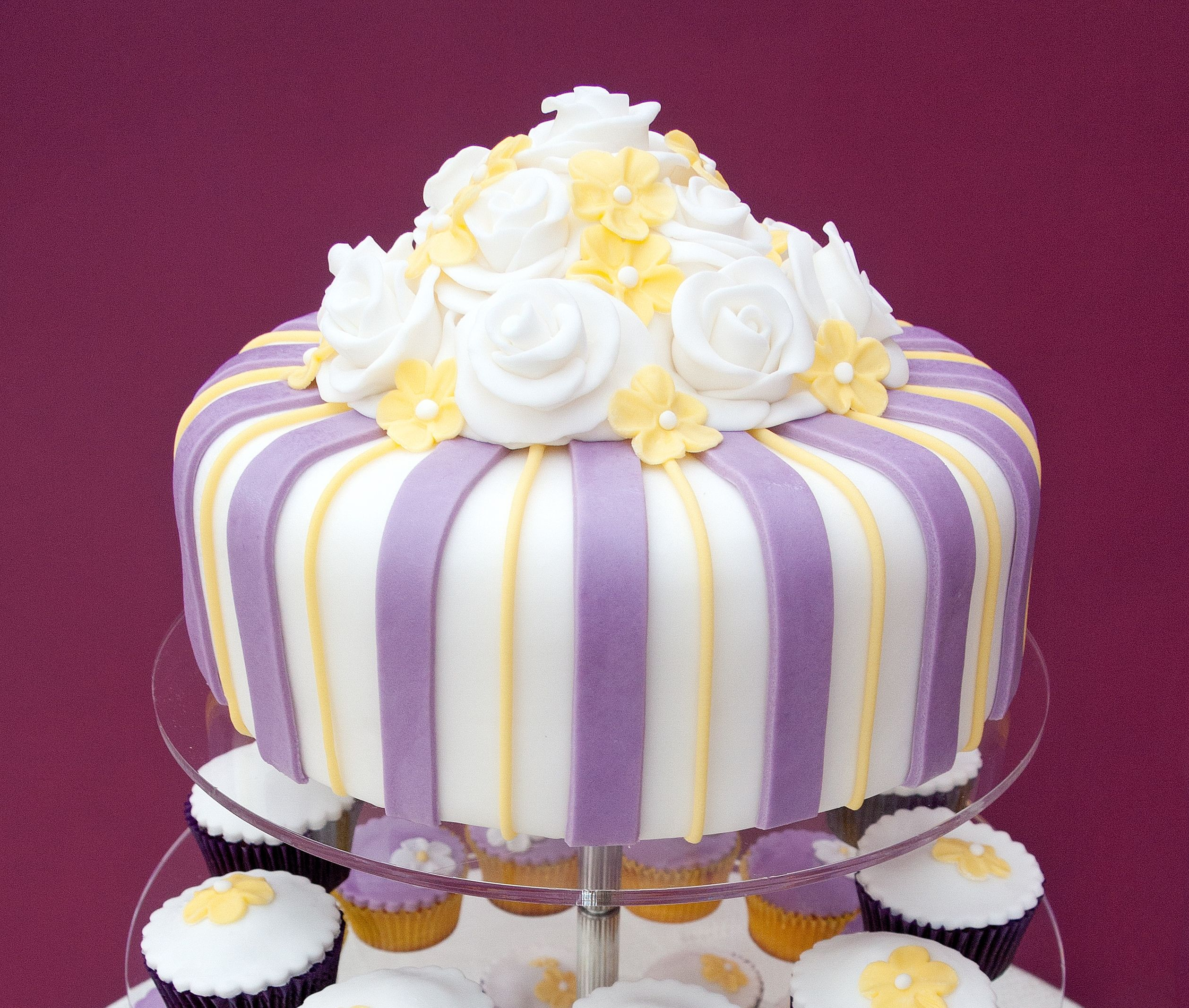 Lemon and lilac wedding cake with white roses