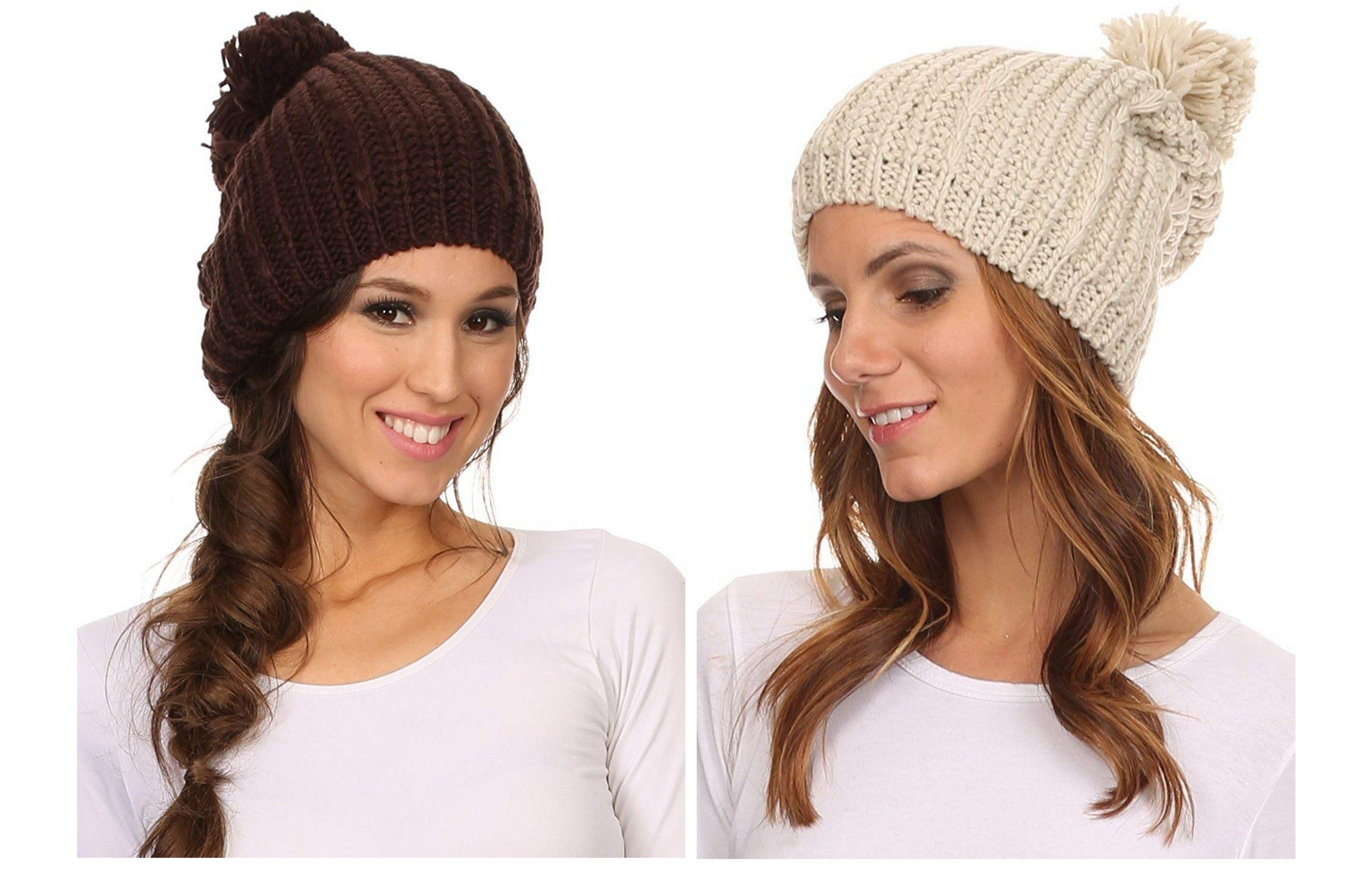 a35fb8cbfb0 Features cable knit pattern with large 5.5 inch (13 cm) pom pom ball at  top. Hat is widest at center base. Soft with a lot of stretch.