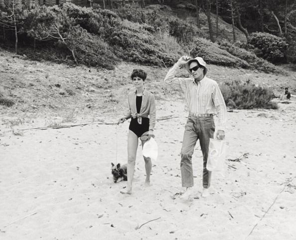 The actress Audrey Hepburn (with Assam of Assam) photographed with her husband Mel Ferrer by Pierluigi Praturlon in St. Tropez, 1966.