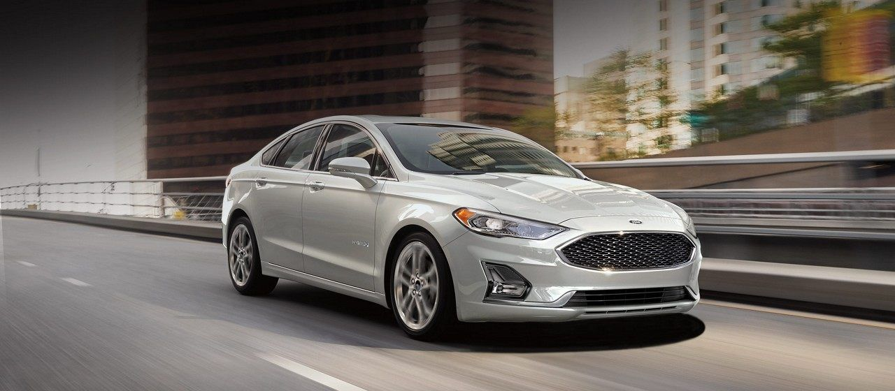 2019 Ford Fusion Shown In White Platinum On The Road With Chrome