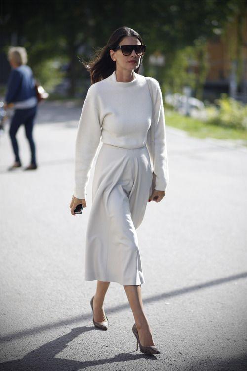 Leila Yavari in white skirt