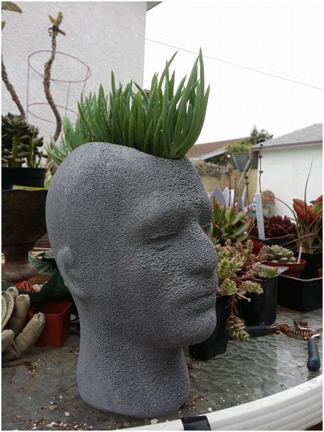 Five Fabulous Examples Of Mannequin Heads As Floral Pots Head