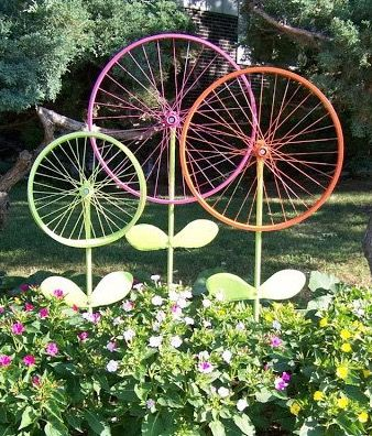 Display Colorful Flowers On This Metal Bicycle Planter Adding A Rustic And Charming Touch To Your Patio Garden Area
