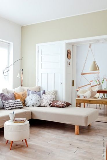 Living room with a wooden floor decorated with pastel colors by Femke Pastijn