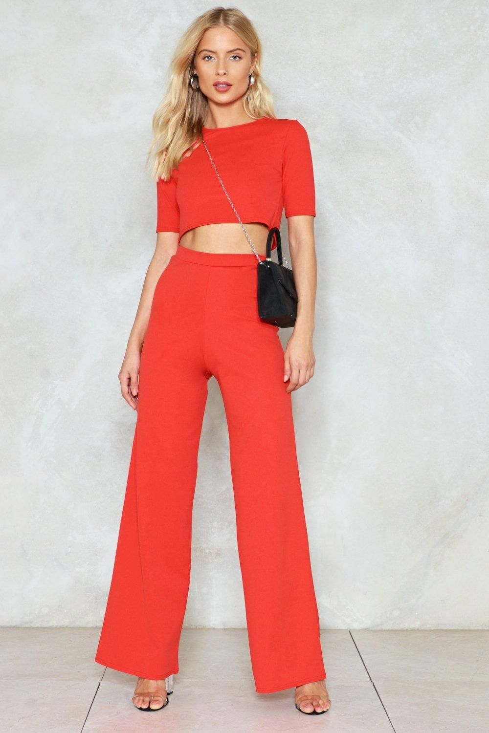 56f4c87cbaebf4 This crop top features a crew neckline and cropped silhouette. The matching  pants feature an elasticized waist and high-waisted
