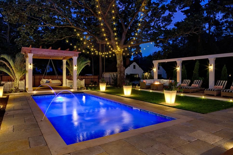 Coastal inspired outdoor space with pool pergola and swing bed