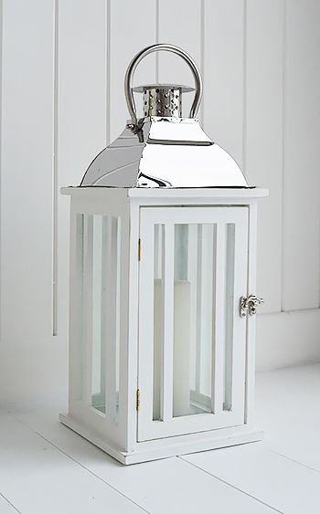 A Large White And Chrome Hurricane Lantern From The White