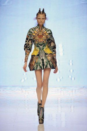 * Alexander McQueen (British, 1969–2010). Dress Plato's Atlantis, spring/summer 2010. Silk jacquard in a snake pattern embroidered with yellow enamel paillettes in a honeycomb pattern. Photo Sølve Sundsbø