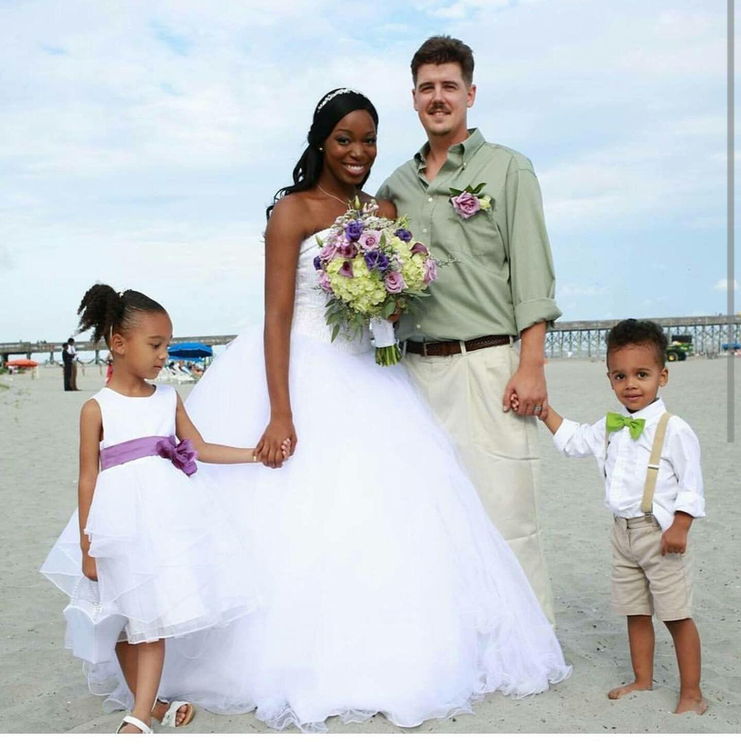 Family is God's masterpiece! love this one#family #Godsmasterpiece #interracialmarriage #love #beautiful #BWWM #WMBW #swirllife #fashionistas #stylishbunch #perfectblend #photography #Beachshot #Teamswirl #Swirling #Loveconquersall #Newlyweds #Beachwedding #Bridalgown #Bouquet #fashion #style