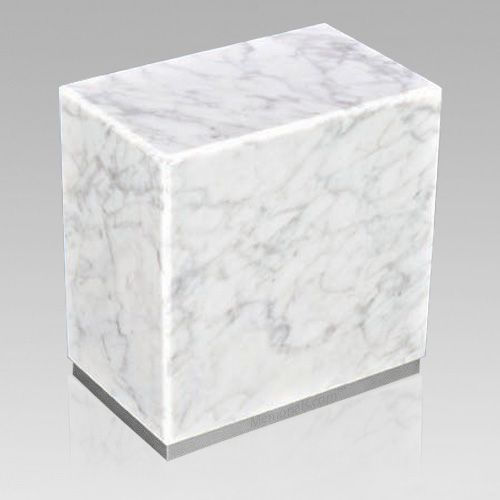 The Dignity Silver Bianco Carrera Marble Urn is assembled from real natural quarried stone. The urn features a stainless steel trim and has a stainless steel or 24k gold plated decoration option. The bottom has felt to protect the surface were the urn stands. This wonderful natural stone urn will create a dignified resting place for eternity to come.